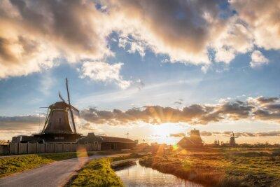Traditional Dutch windmills against sunset in Zaanse Schans, Amsterdam area, Holland