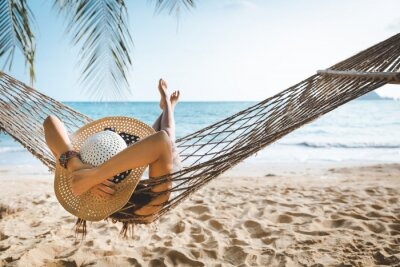 Poster Traveler asian woman relax in hammock on summer beach Thailand