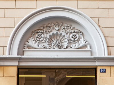 Trieste, Italy, August 7, 2019. Fragment of the facade of the building in the historical building area