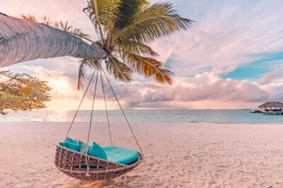 Poster Tropical beach sunset as summer landscape with luxury resort beach swing or hammock and white sand and calm sea for sunset beach landscape. Tranquil beach scenery vacation and summer holiday concept.