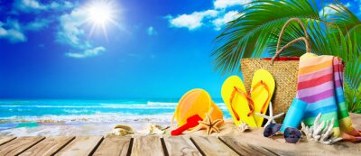 Poster Tropical beach with sunbathing accessories, summer holiday background