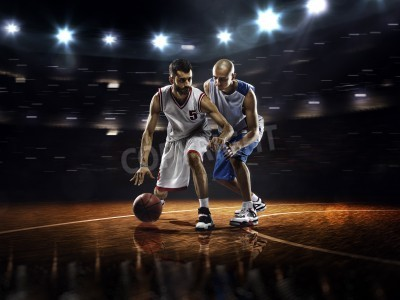 Poster Two basketball players in action in gym in lights