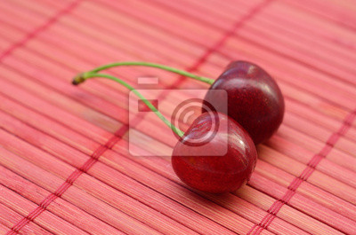 Two fresh cherry on pink background