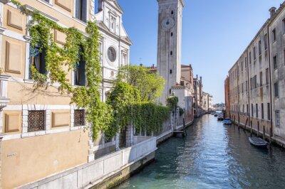 Venice boats along city canal, Italy