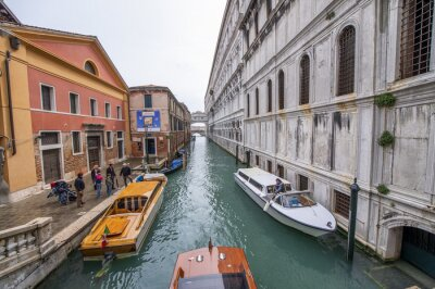 VENICE, ITALY - APRIL 2014: Boats along the city canals in spring