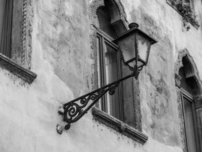 Verona, Italy, on April 24, 2019. Typical architectural details of a facade of the building in the old city. The beautiful lamp decorates the building