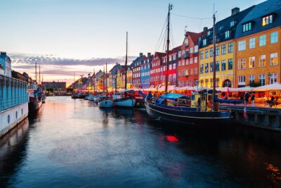 View of famous Nyhavn area in the center of Copenhagen, Denmark at evening