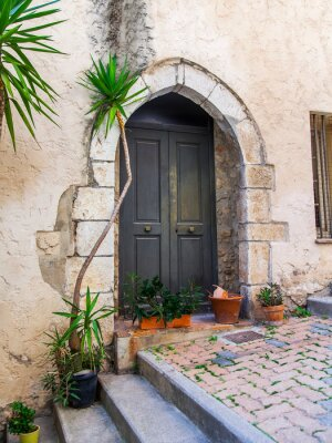 Villefranche-sur-Mer, France, October 10, 2019. Typical architecture of Provence. Fragment of the facade of the building in the old city. The traditional design of the front door