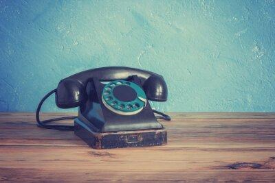 Poster Vintage Telefon auf einem Holztisch