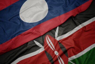 Poster waving colorful flag of kenya and national flag of laos.