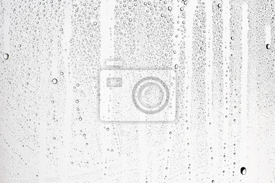 Poster white isolated background water drops on the glass / wet window glass with splashes and drops of water and lime, texture autumn background
