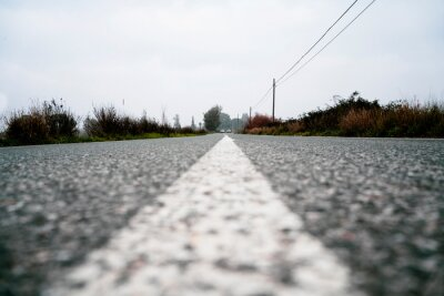 Poster white line painted on the road