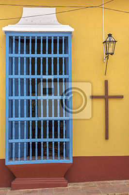 Window of a colonial house with a Christian Cross in Trinidad