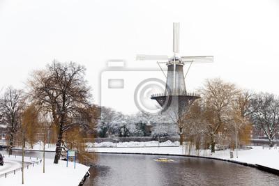 Winter view on mill 'De Valk' in Leiden, the Netherlands
