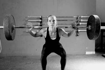 Poster woman on a weightlifting session - crossfit workout.