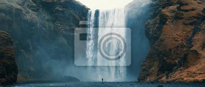 Poster Woman overlooking waterfall at skogafoss, Iceland. Skógafoss, Ísland.