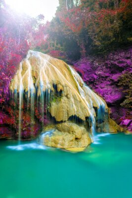 Poster wonderful waterfall with colorful tree in thailand
