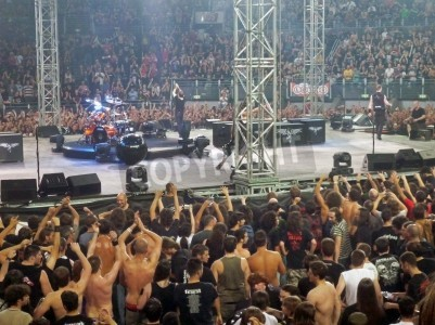 """Poster Concert of the band """"Metallica"""", Rome 24 June, 2009. People near the stage."""