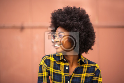 Poster young african american woman with afro and glasses looking away