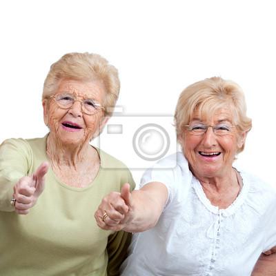 Zwei ältere Frau zeigt Daumen nach oben.