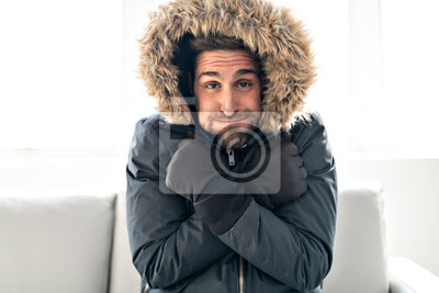 Sticker A Man have cold on the sofa at home with winter coat