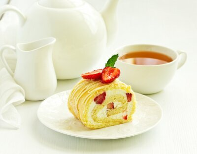 A piece of biscuit roll with cream and strawberry.