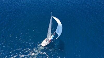 Sticker Aerial drone top down photo of beautiful sailing boat cruising in deep blue Atlantic open ocean sea