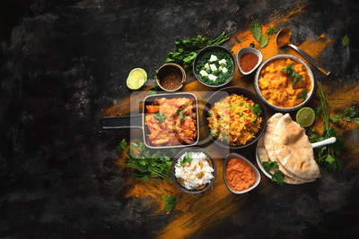 Sticker Assorted indian food on black background..