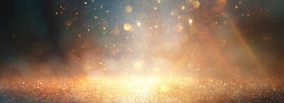 Sticker background of abstract glitter lights. gold, blue and black. de focused