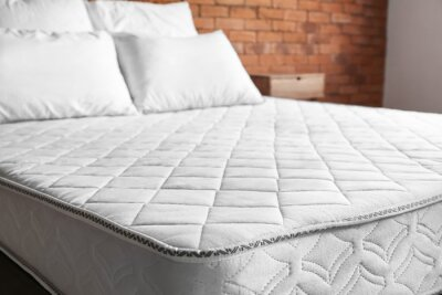 Sticker Bed with comfortable orthopedic mattress in room