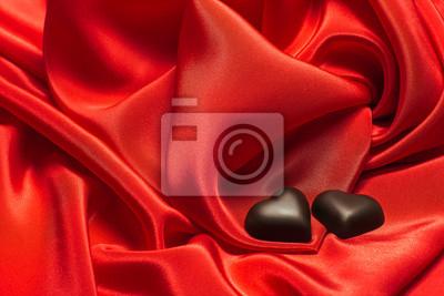 Black chocolate on red silk
