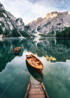 Sticker Boats and slip construction in Braies lake with crystal water in background of Seekofel mountain in Dolomites in morning, Italy Pragser Wildsee