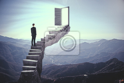 Businessman on stairs with door