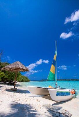 Sticker Catamaran over a wonderful tropical beach