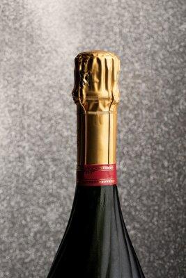 Champagner-Flasche gegen glitter Hintergrund