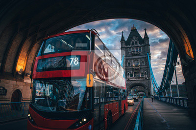 Classic red double decker at the tower Bridge in London. UK. Traffic in london