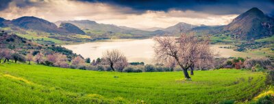 Sticker Colorful morning panorama of the lake Rosamarina