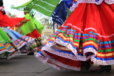 Sticker Colorful skirts fly during traditional Mexican dancing