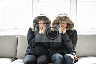 Sticker Couple have cold on the sofa at home with winter coat