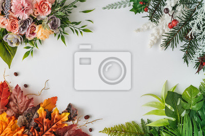 Sticker Creative season layout of colorful summer, spring, autumn and winter leaves and flowers. Nature mockup background. Seasonal concept. Flat lay