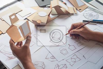 Sticker Designer sketching drawing design Brown craft cardboard paper product eco packaging mockup box development template package branding Label . designer studio concept .