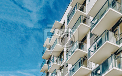Sticker Detail of Modern residential apartment flat building exterior. Fragment of New luxury house and home complex. Part of City Real estate property and condo architecture. Copy space. Blue sky