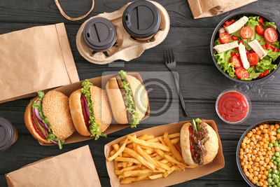 Sticker Different tasty food from delivery service on wooden background