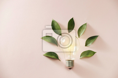 Sticker Eco green energy concept bulb, lightbulb leaves on pink background.