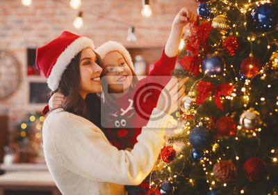 Sticker Festive mother and daughter decorating Christmas tree at home