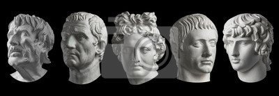 Sticker Five gypsum copy of ancient statue heads isolated on a black background. Plaster sculpture mans faces.
