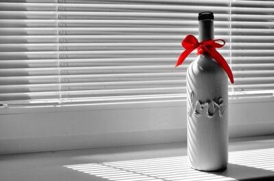 Flasche mit tittle LOVE und mit rotem Band