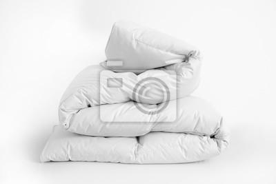 Sticker Folded soft white duvet, blanket or bedspread, against white background. Close up photo