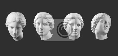 Sticker Four gypsum copy of ancient statue Venus head isolated on black background. Plaster sculpture woman face.
