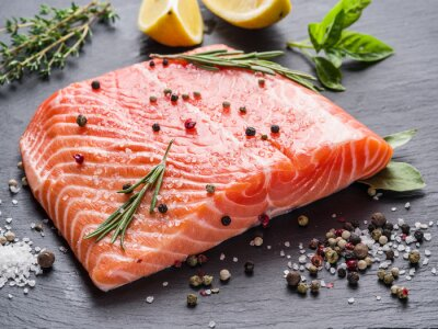 Sticker Fresh salmon on the black cutting board.